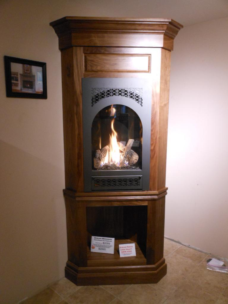 avalon hideaway portrait style gas fireplace in a walnut
